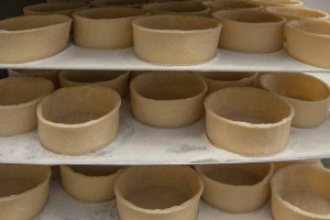 Murrays Bakers - Pie shells now put on tin, then in the rack