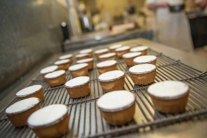 Murrays Bakery - A tray of pineapple cakes ready for fondant
