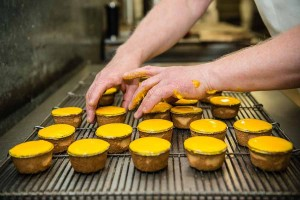 Murrays Bakery - Arranging the Pineapple cakes onto a wire tray